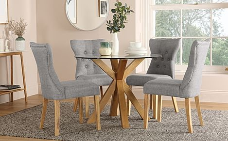 Hatton Round Oak and Glass Dining Table with 4 Bewley Light Grey Fabric Chairs