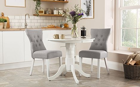 Kingston Round White Dining Table with 2 Bewley Light Grey Fabric Chairs