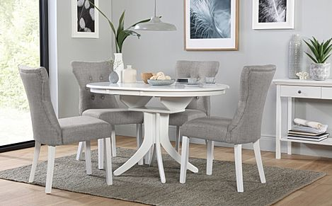 Hudson Round White Extending Dining Table with 6 Bewley Light Grey Fabric Chairs