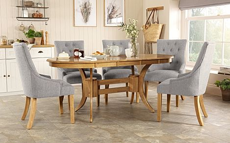 Townhouse Oval Oak Extending Dining Table with 4 Duke Light Grey Fabric Chairs