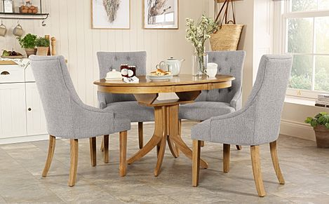 Hudson Round Oak Extending Dining Table with 4 Duke Light Grey Fabric Chairs