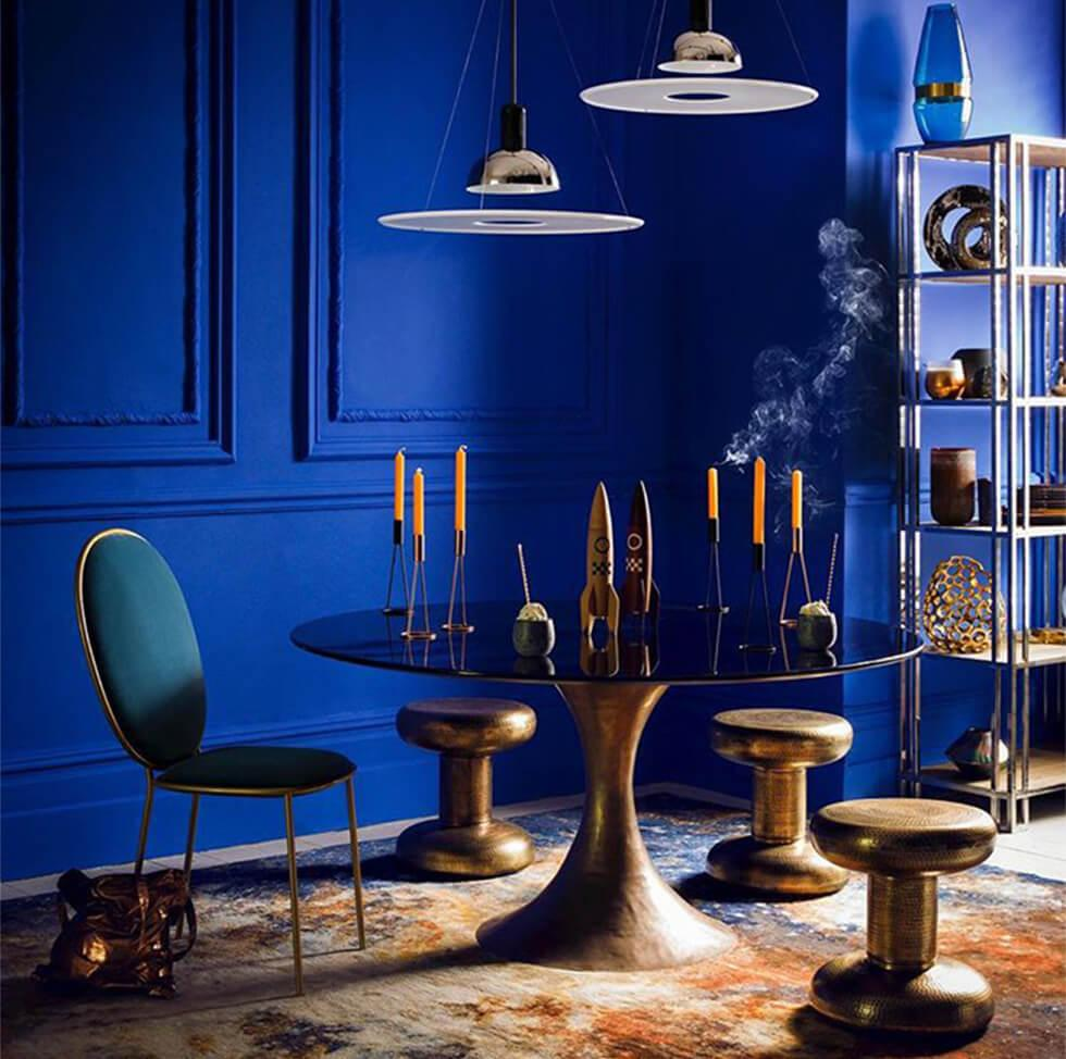 modern eclectic living room with pantone classic blue walls