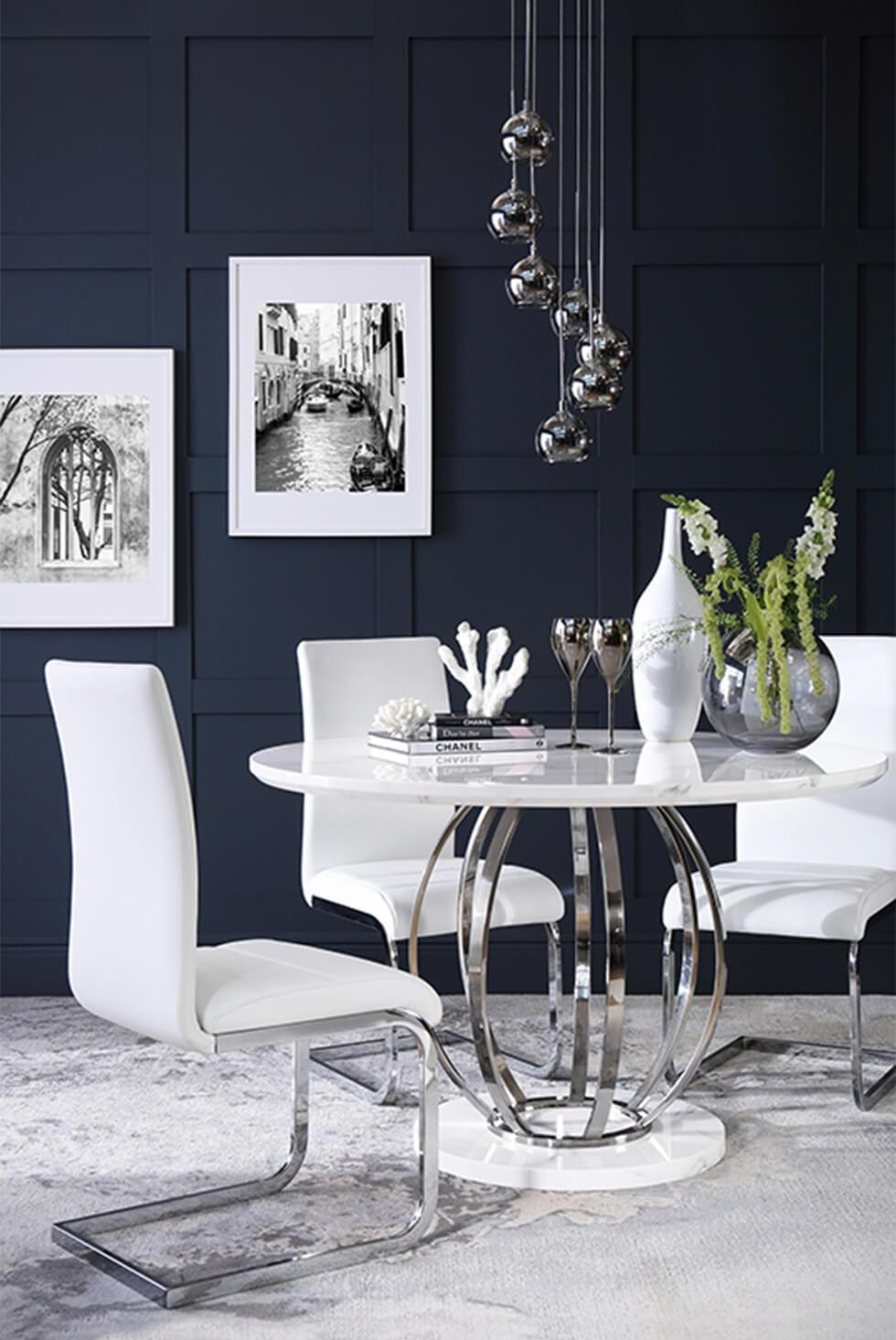 white marble and chrome table in a modern navy dining room