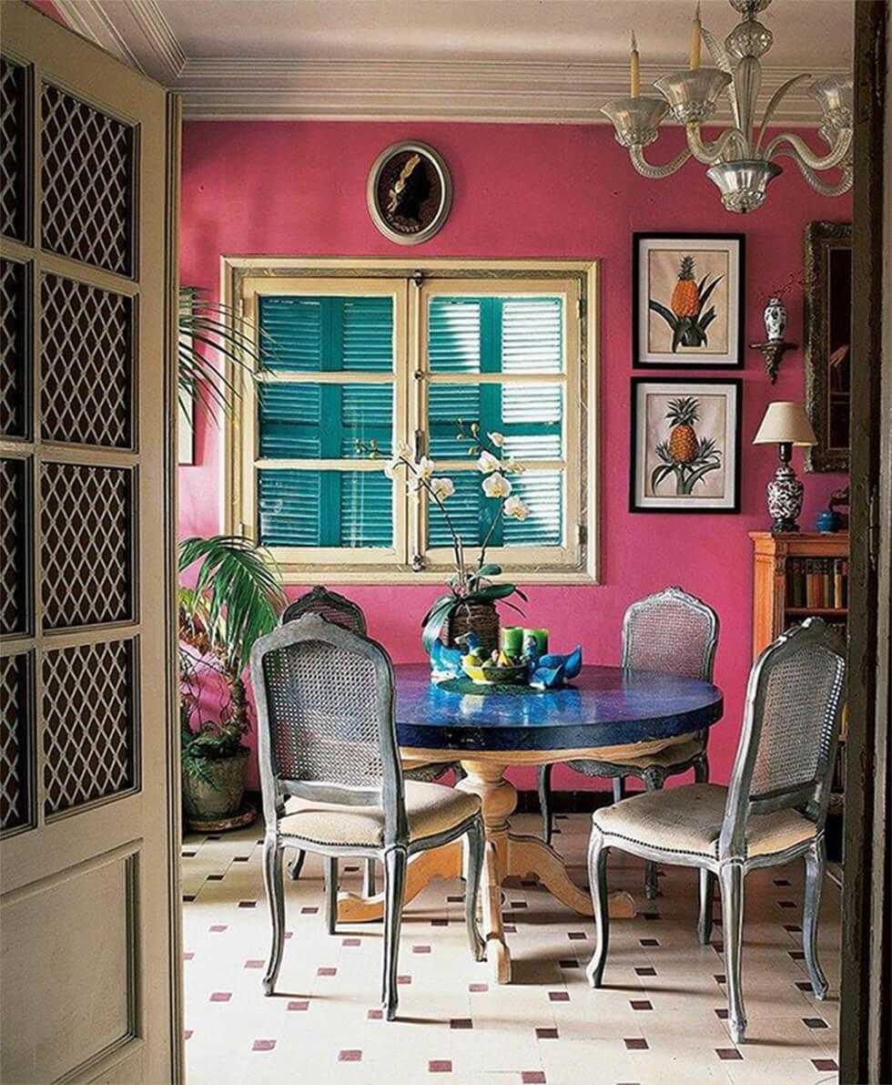 bright pink walls in a colourful modern dining room