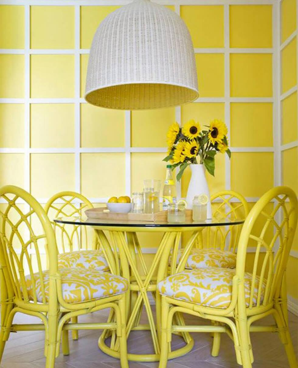 sunshine yellow patterned walls in a modern dining room