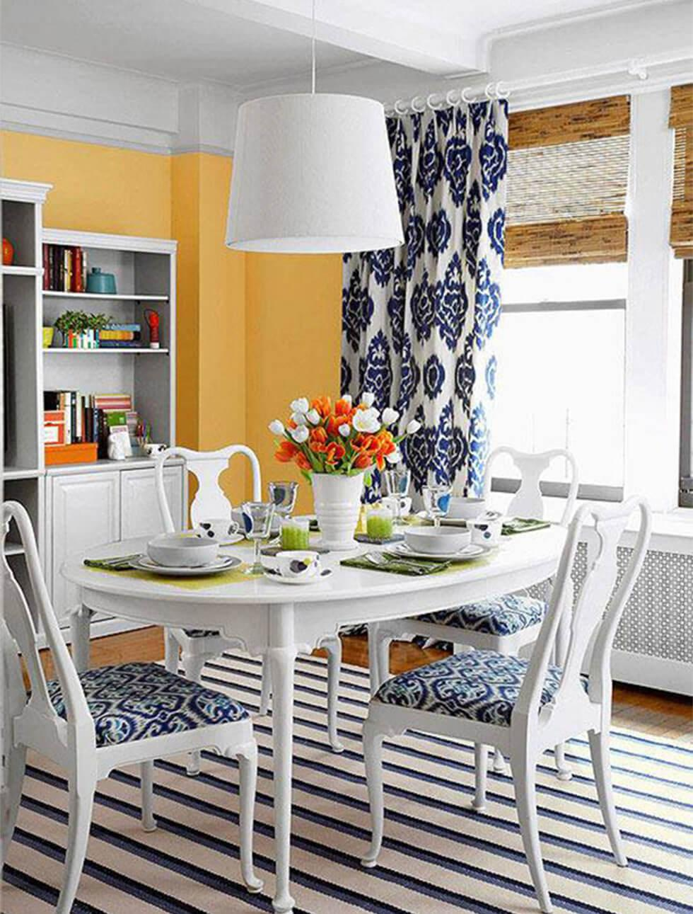 marigold orange walls in a French farmhouse dining room