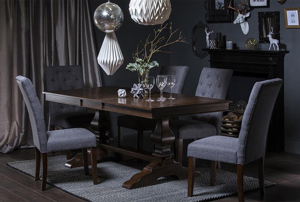 dark grey formal dining room with dark wood dining set