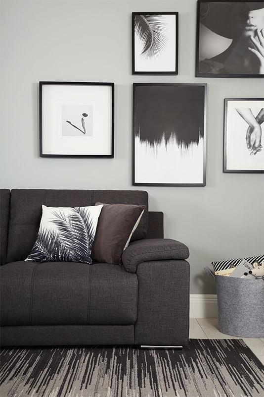 Slate grey sofa in a monochrome living room.