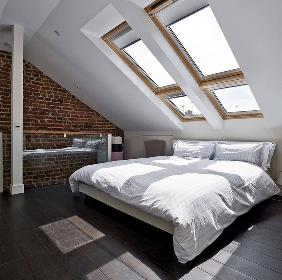 Light and airy loft bedroom with large windows