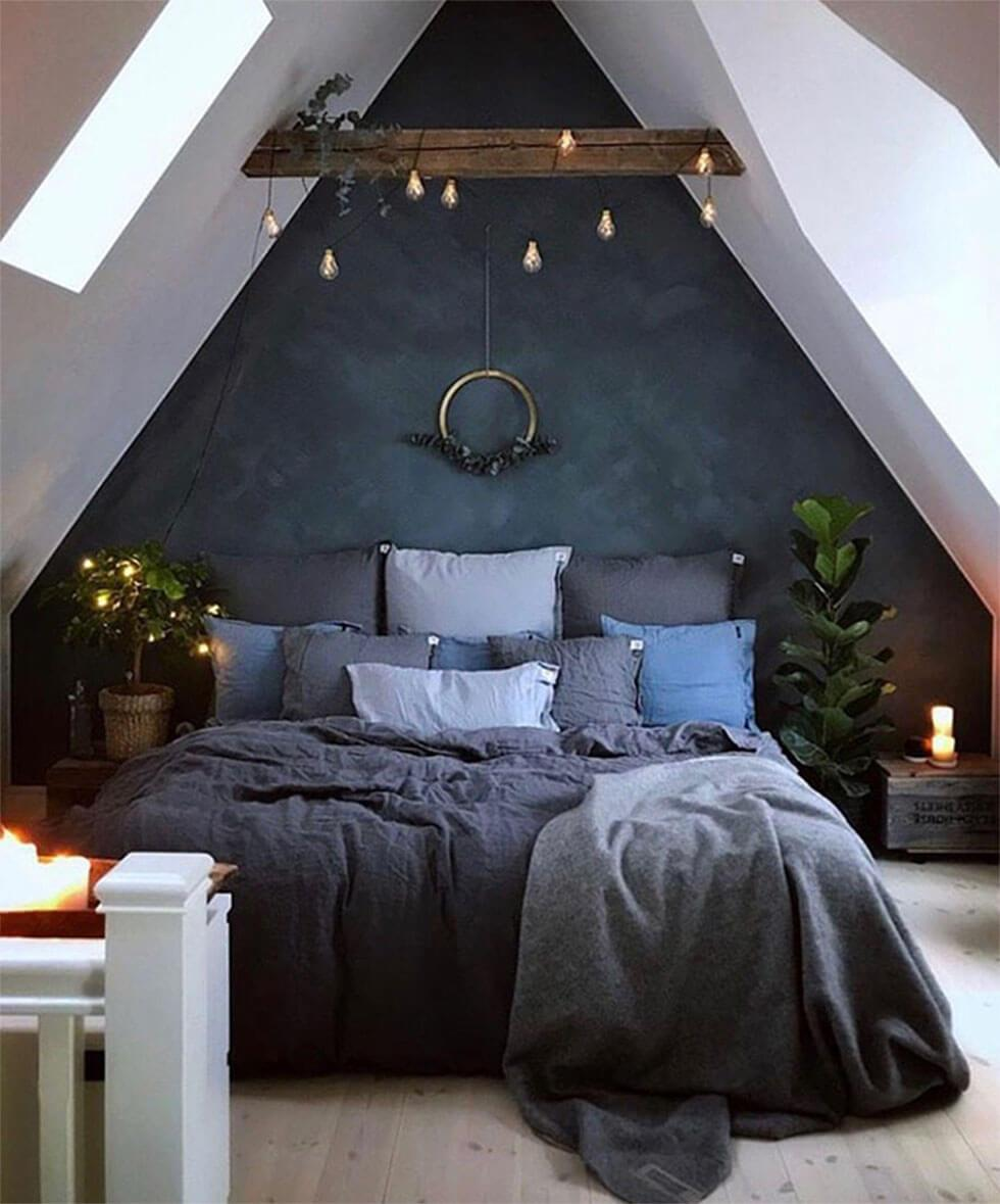 Navy blue loft bedroom with a strong mystical touch