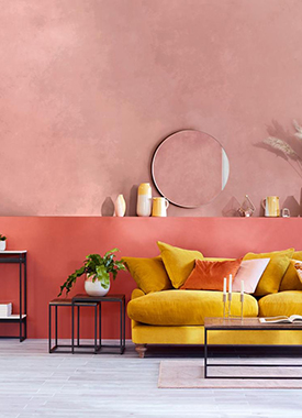Jewel tone pink walls with a yellow sofa in a contemporary living space