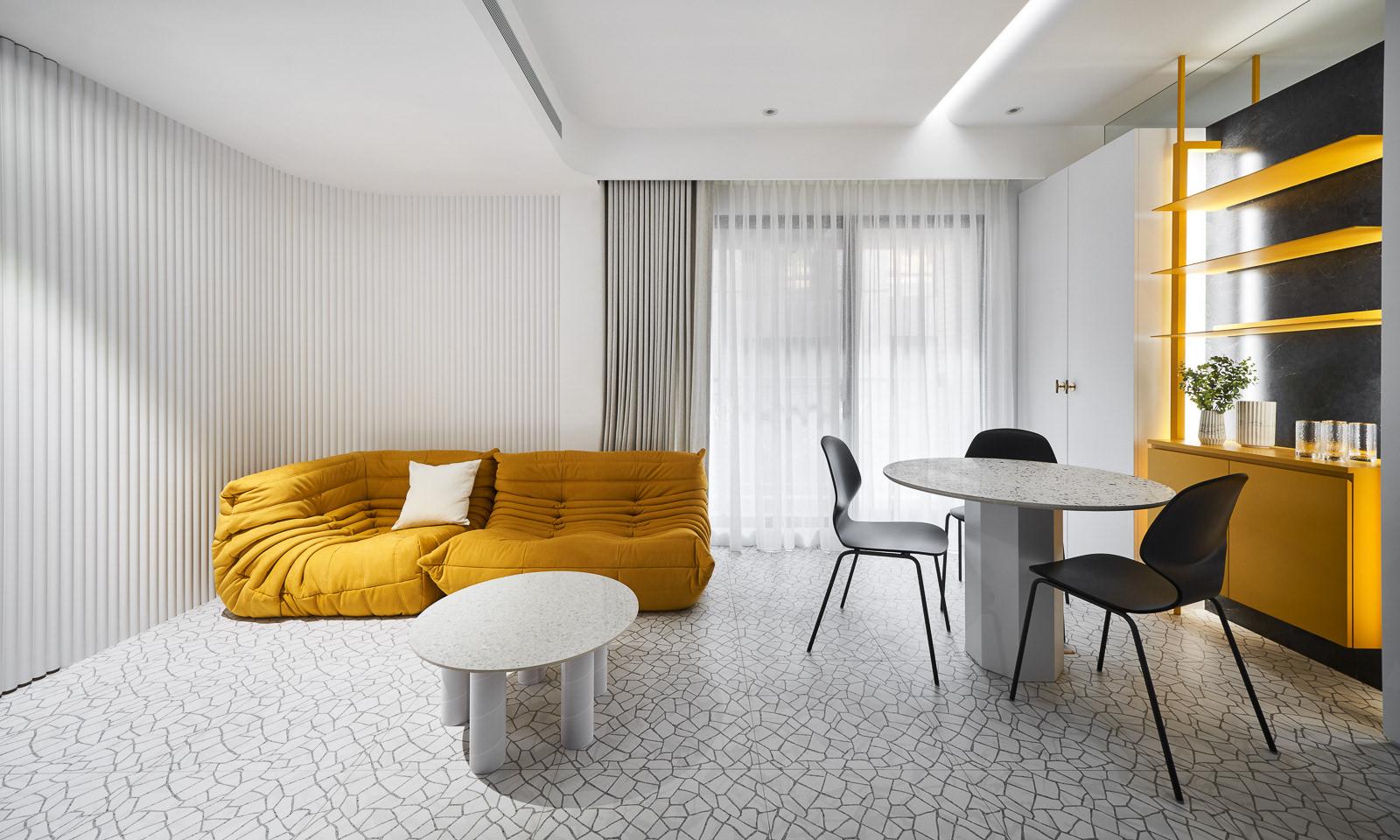 Mustard yellow sofa in a modern grey living room