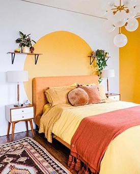 Painted yellow motif as a creative headboard