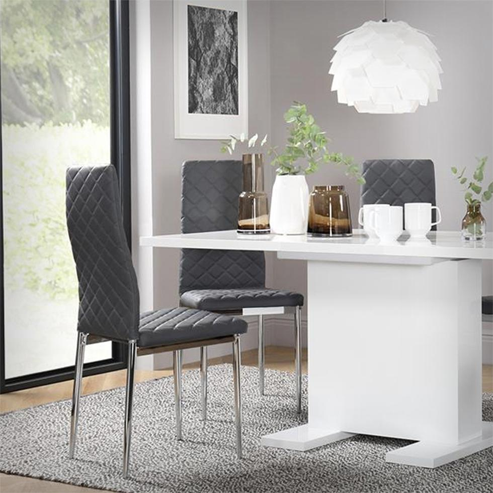 White high gloss dining table with grey leather chairs in a modern grey dining room