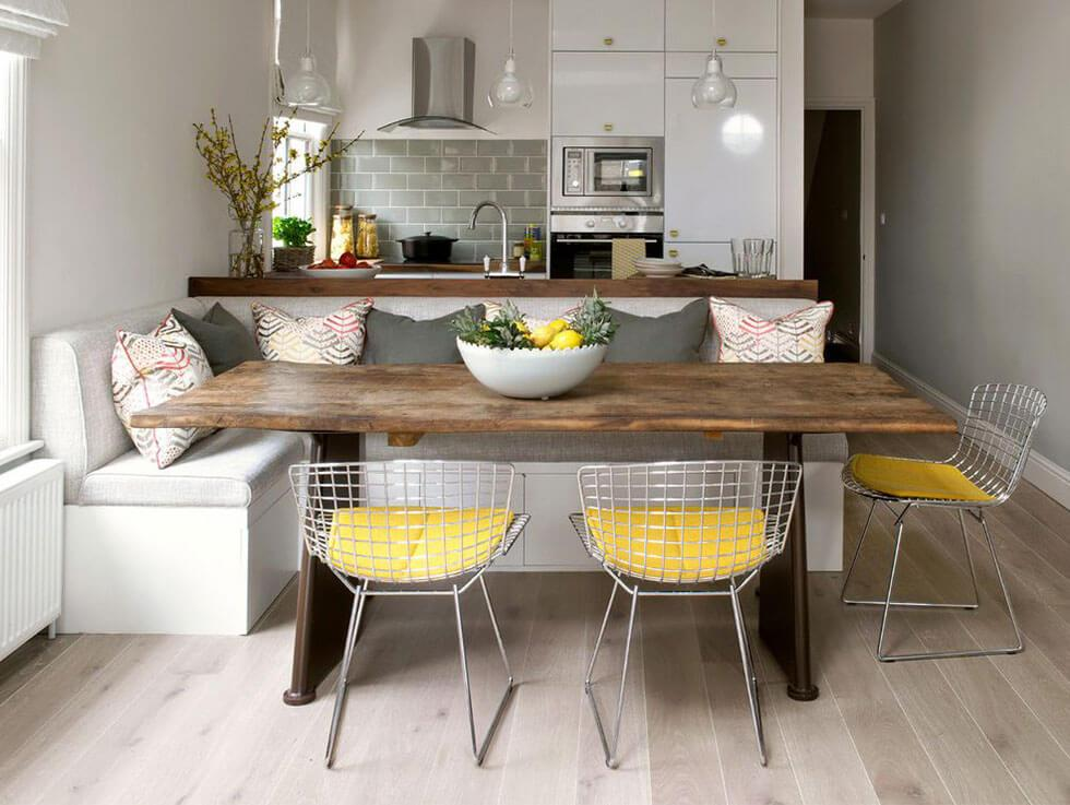 bright pops of yellow seats in a fun grey dining room