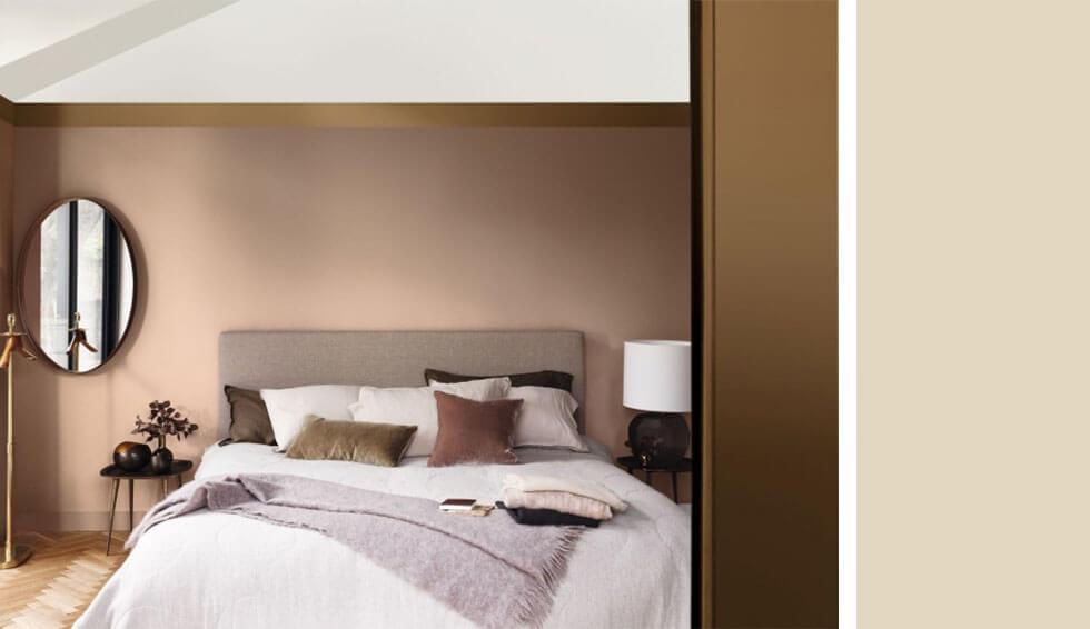 Cosy bedroom with caramel walls and comfy bedding