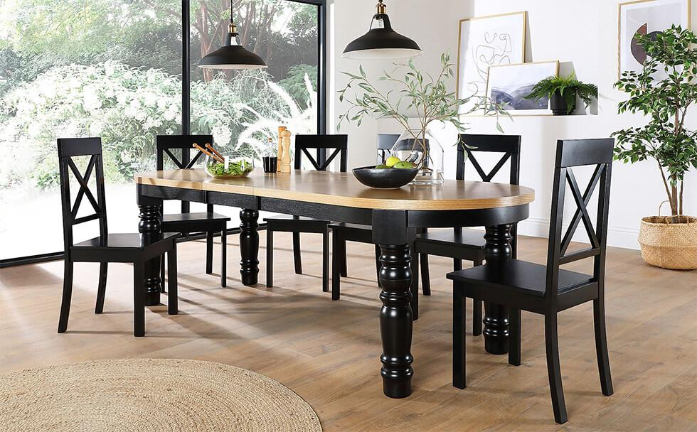 A two tone black and oak dining table in a modern yet natural dining area