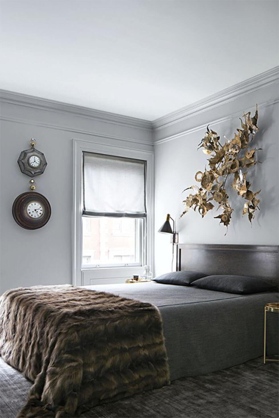 Relaxing neutrals in a stylish bedroom with grey-painted walls.