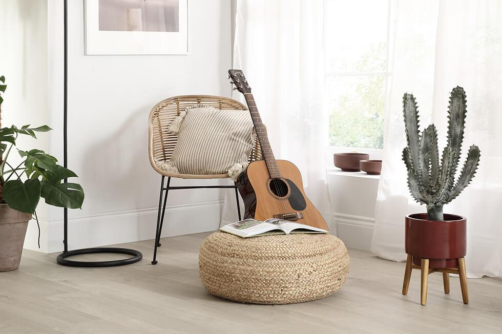 guitar and plants in a neutro modern boho space