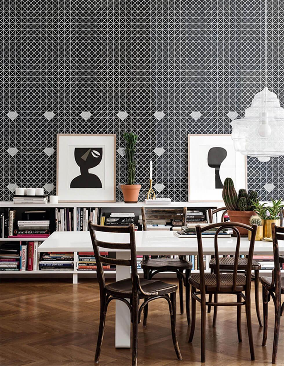 Modern dining room with geometric feature wall