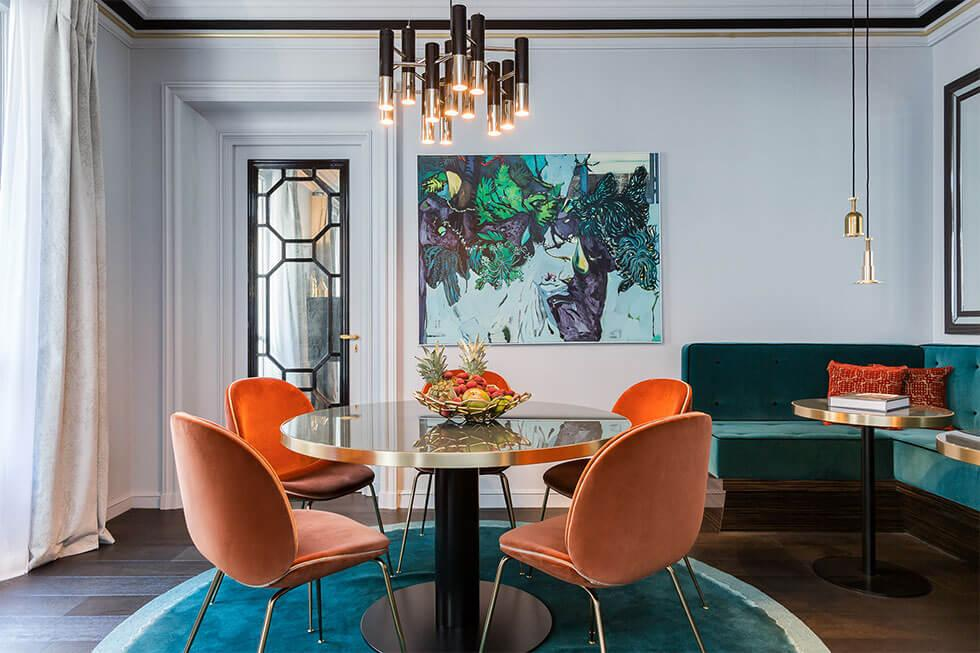 Modern dining room with velvet teal rug
