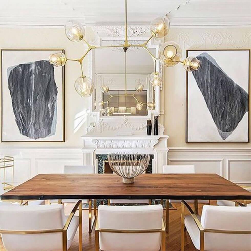 Modern dining room with wooden table and fabric chairs with gold accents