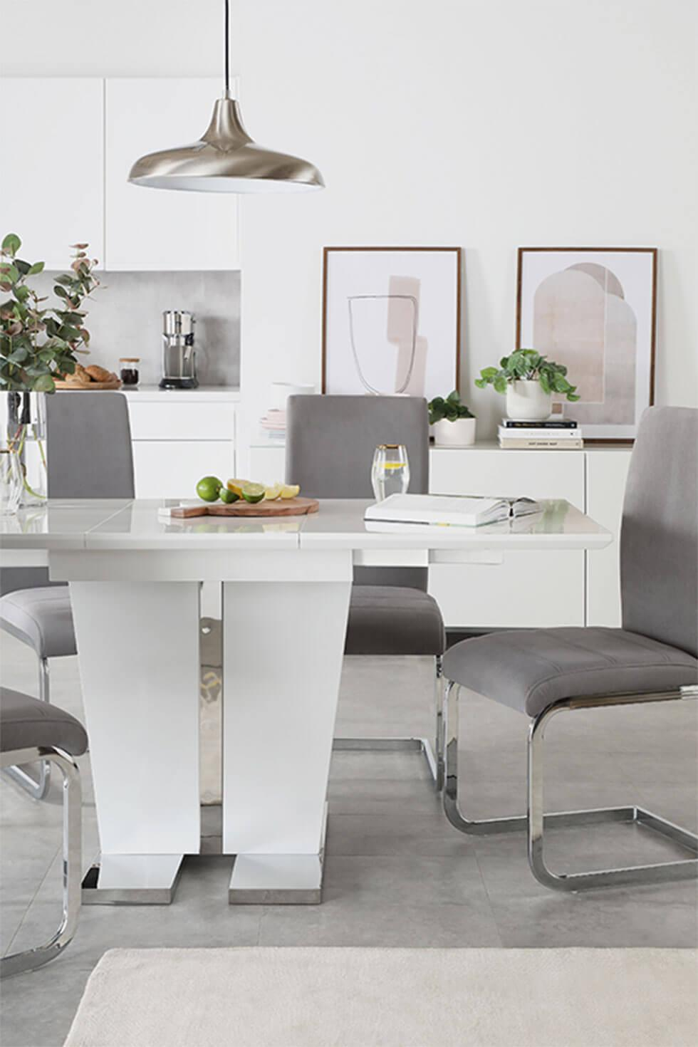 Contemporary dining room with grey dining chairs and white high gloss table