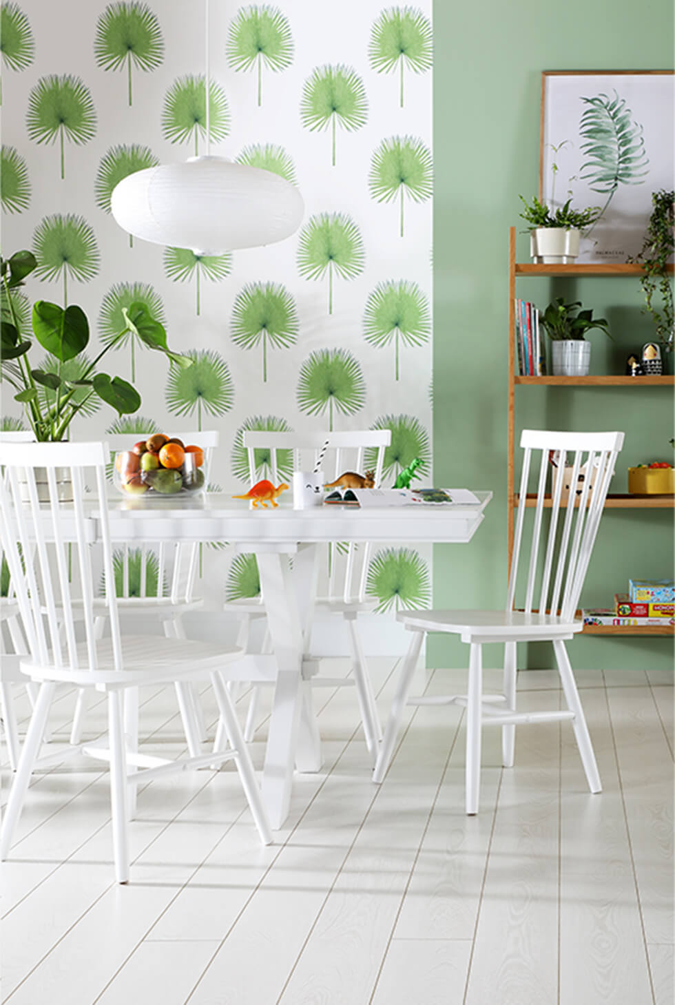White wooden dining set in a calm green room
