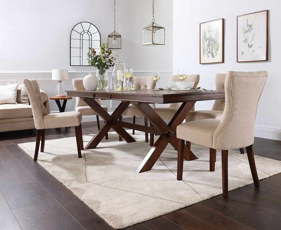 Dark wood extending dining table in an elegant setting