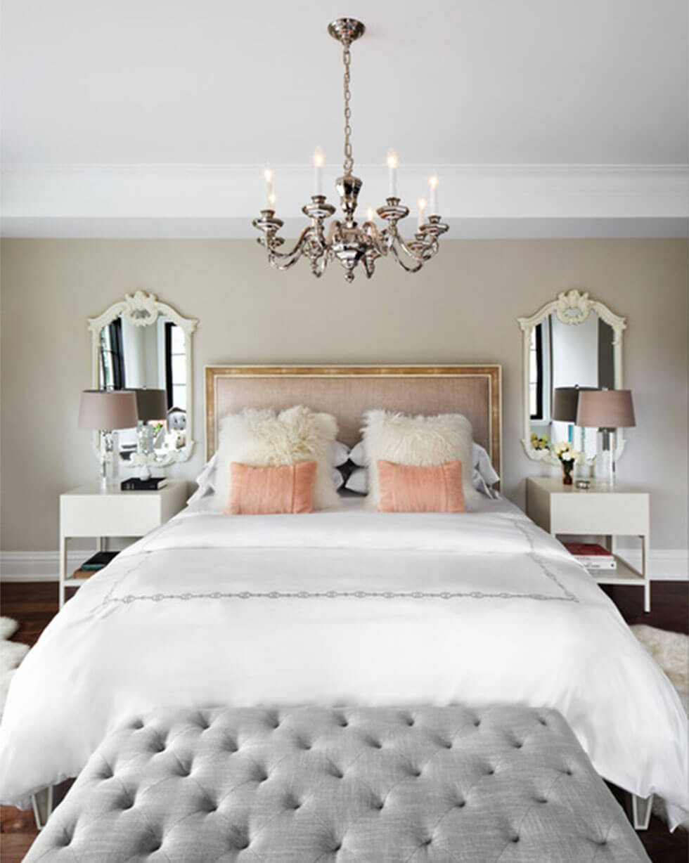 A Parisian chic bedroom with feature bedside mirrors