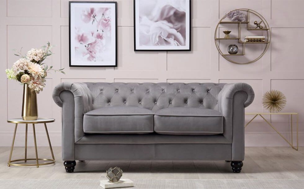 Grey velvet Chesterfield sofa in a chic and lux living room