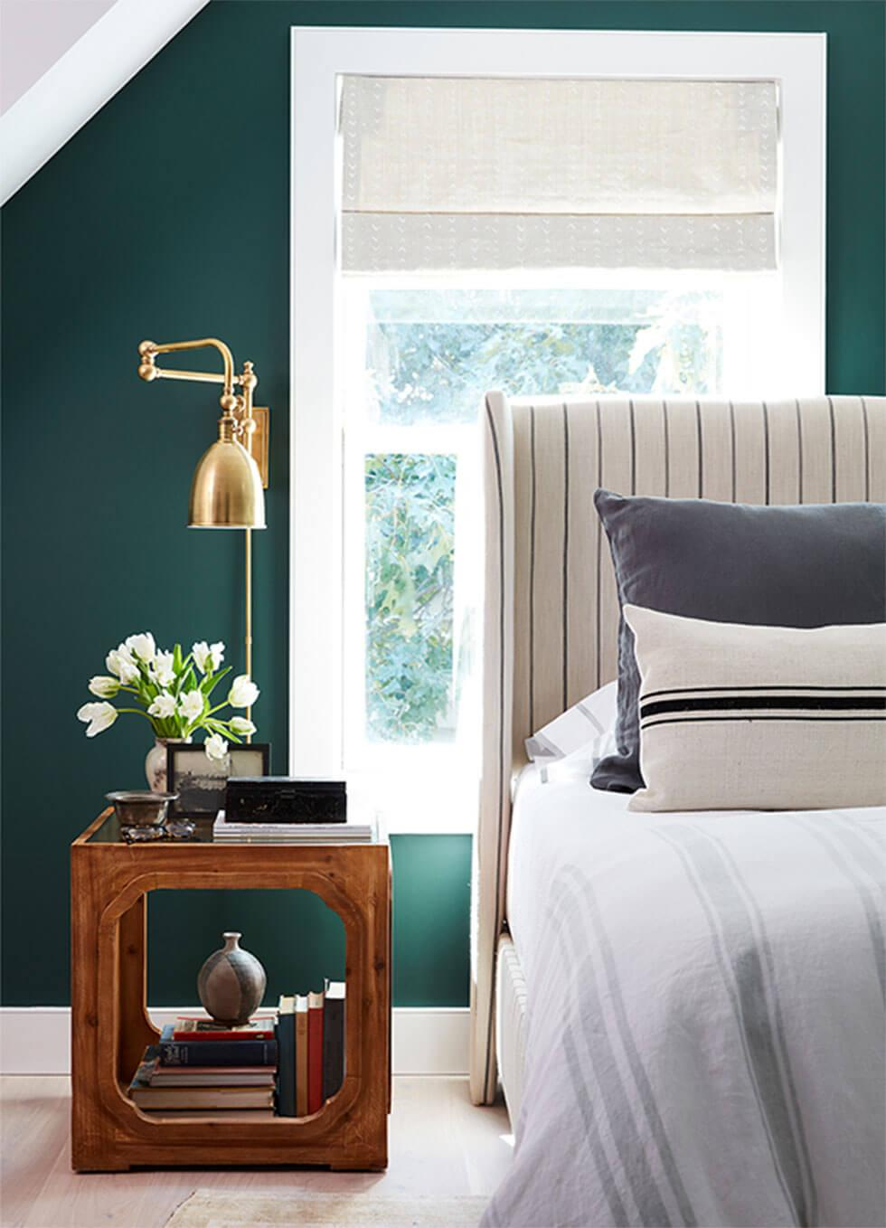 Bedroom feature wall in rich emerald green.