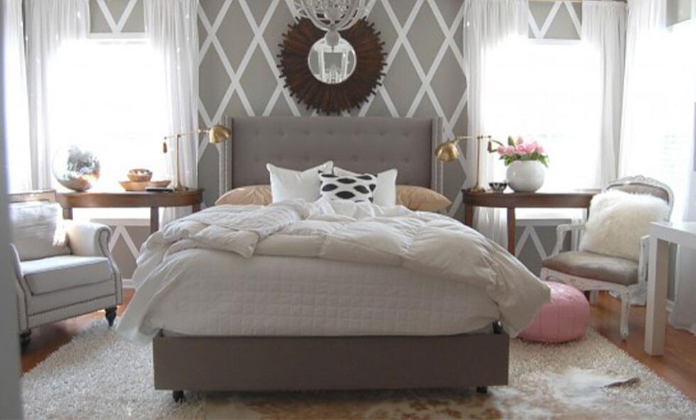 A grey bedroom with a geometric diamond wall.