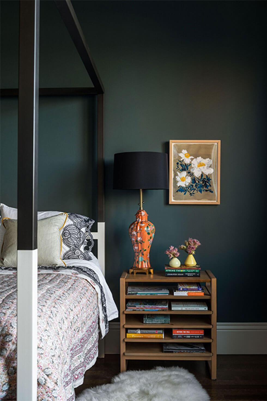 Dark emerald green cosy bedroom.