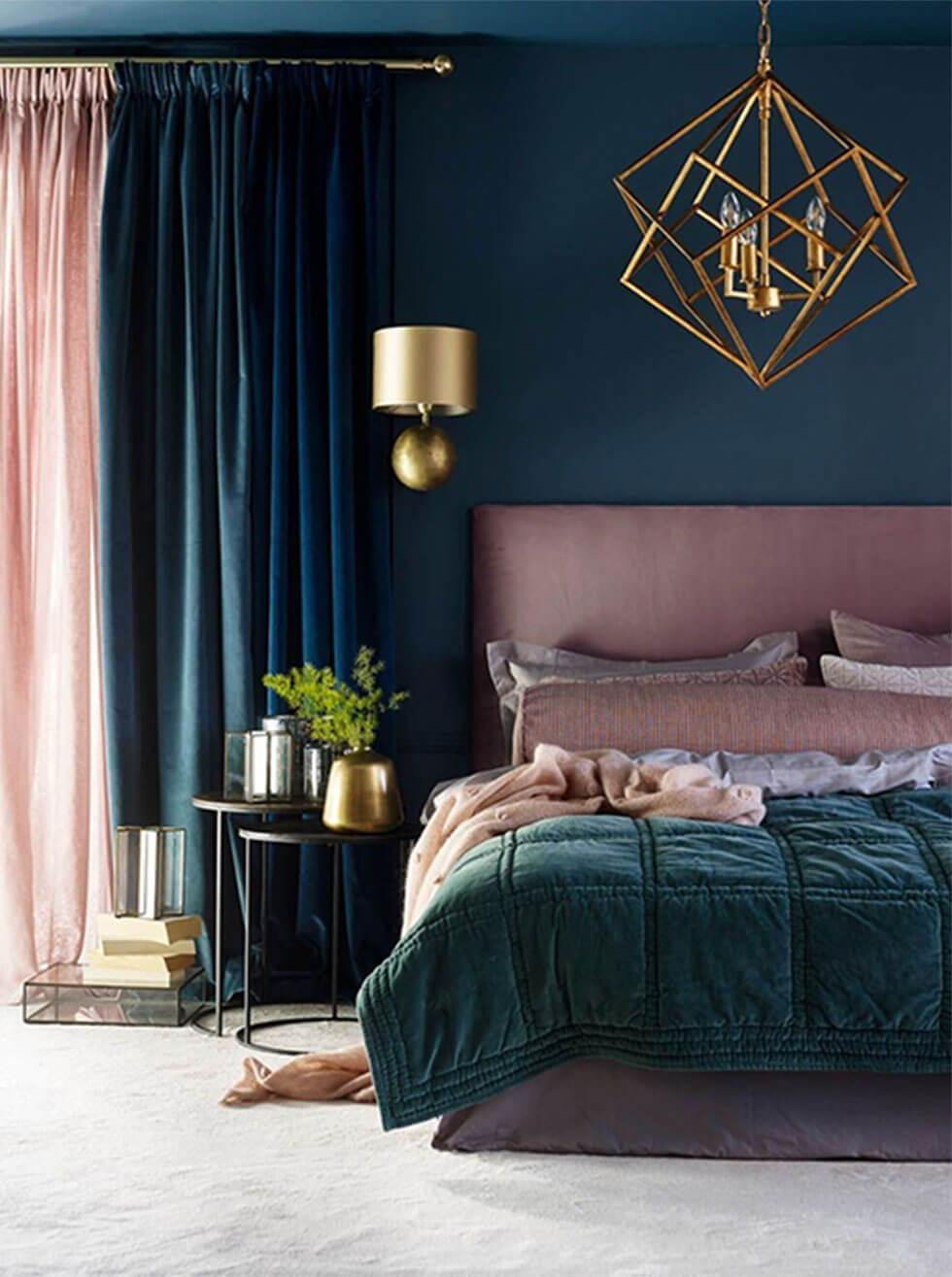 A dark teal green bedroom with dusky pink accents.