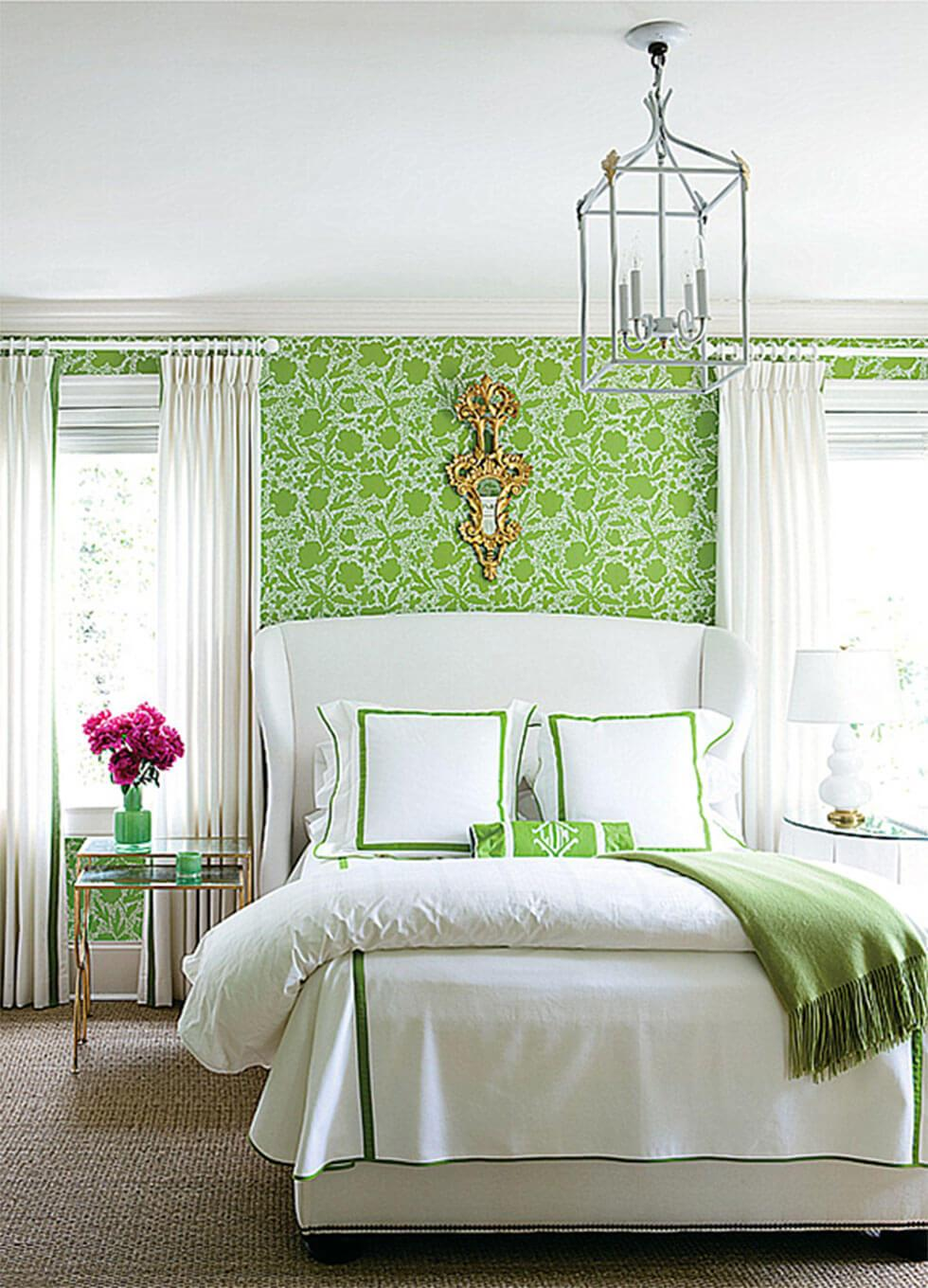 Lime green bedroom with cosy white bedding in a classic mid-century style.