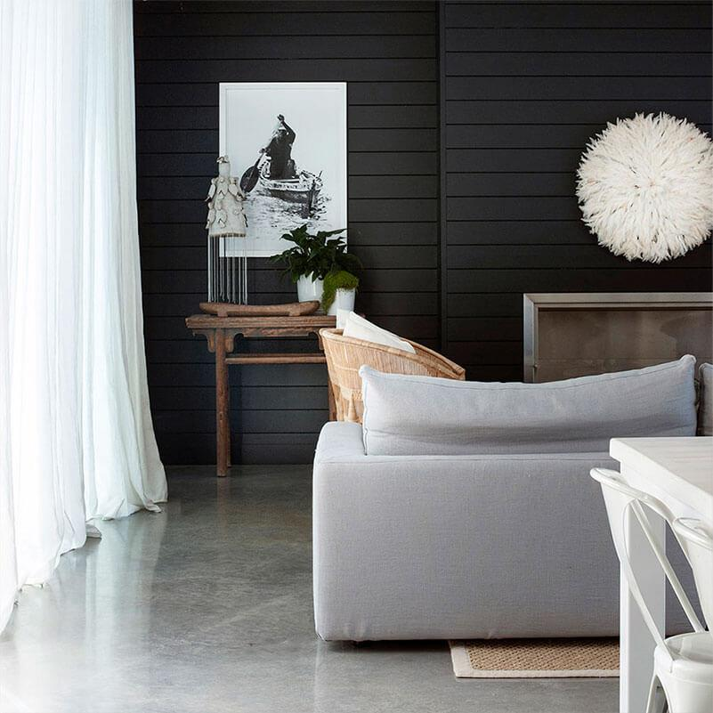 Neutral living room with a grey sofa in modern coastal style