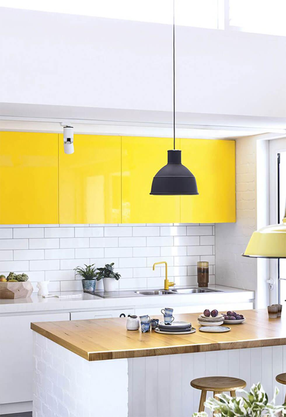 Yellow cabinetry in a contemporary kitchen