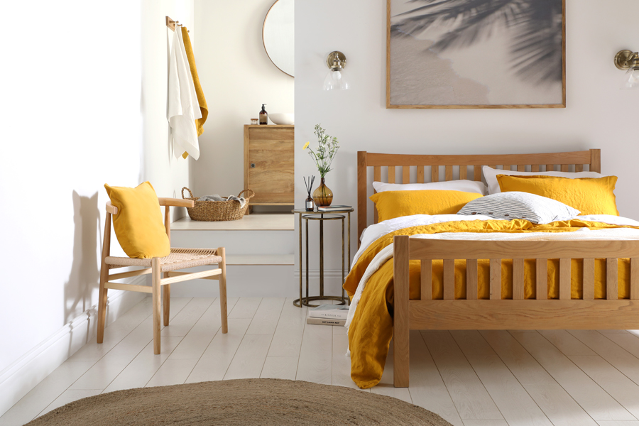 Mustard yellow accents in a neutral and natural bedroom