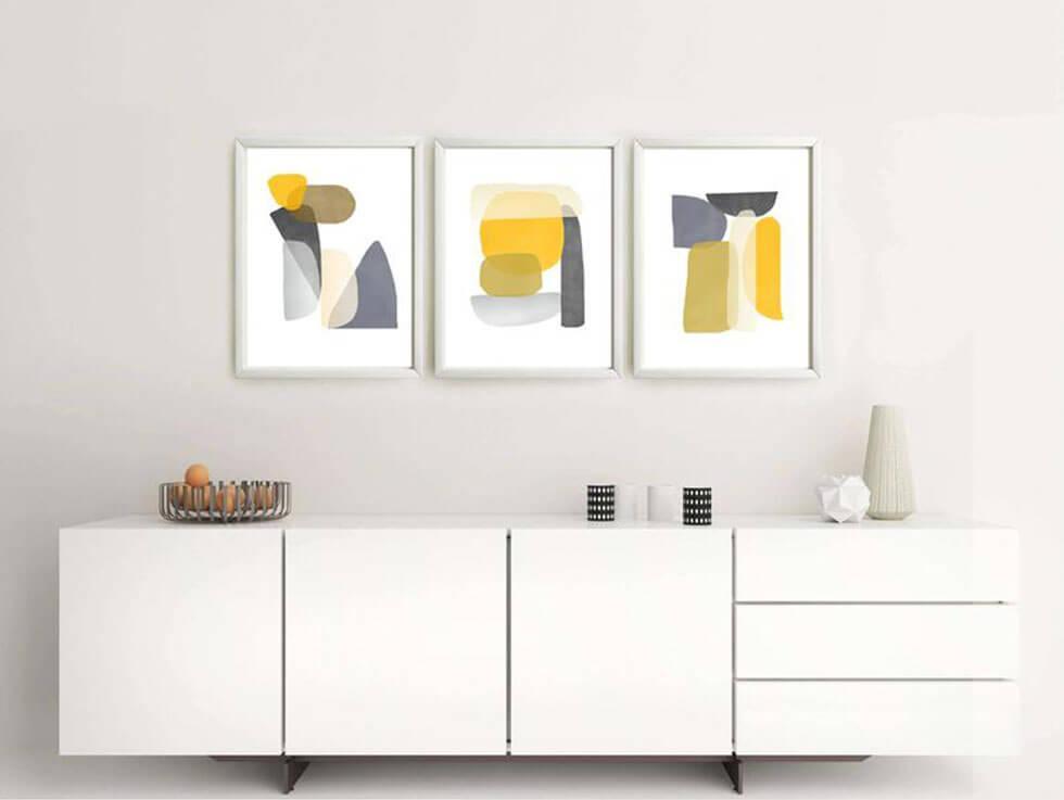 Yellow artwork in a neutral, modern setting