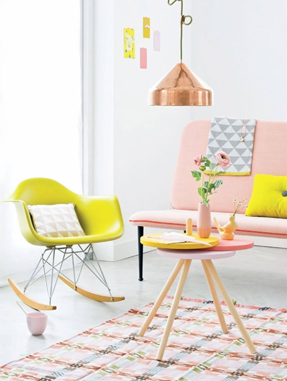 Yellow furniture with metallic accessories in a contemporary living room