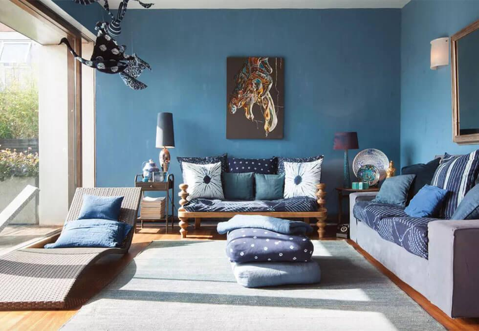 Blue bohemian living room with ikat fabric details.