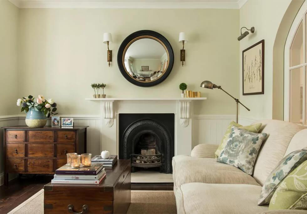 Light sage living room with cream sofa and dark wood furniture