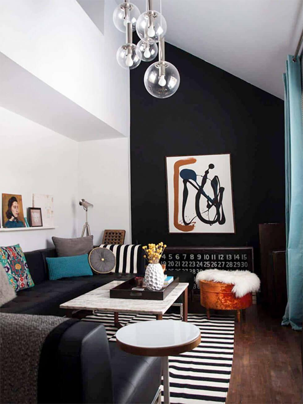 Black and white colour blocked walls and striped accessories