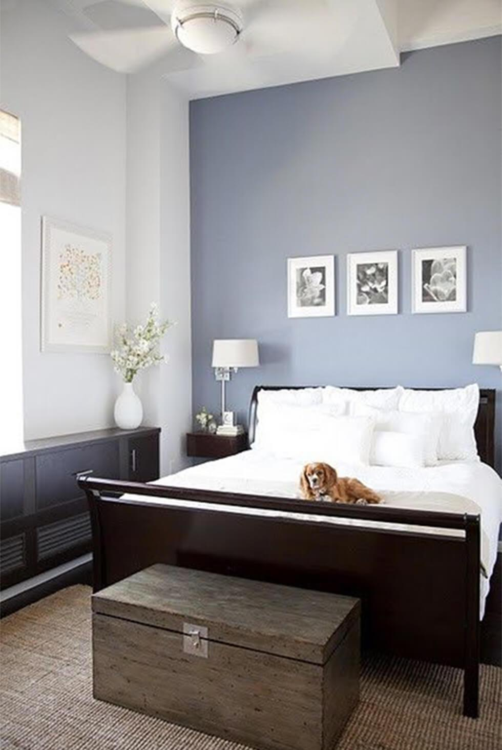 Pale blue bedroom with feature wall