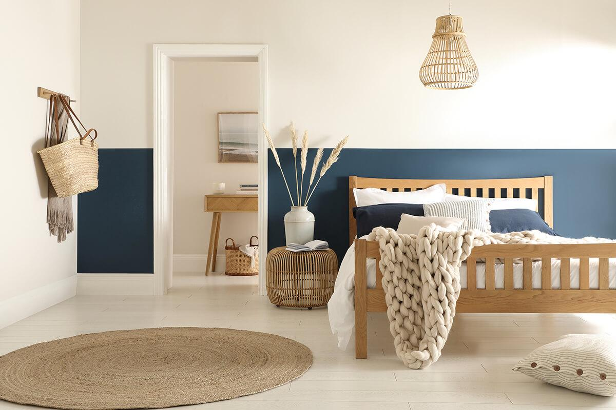 Blue and white bedroom in a modern coastal style