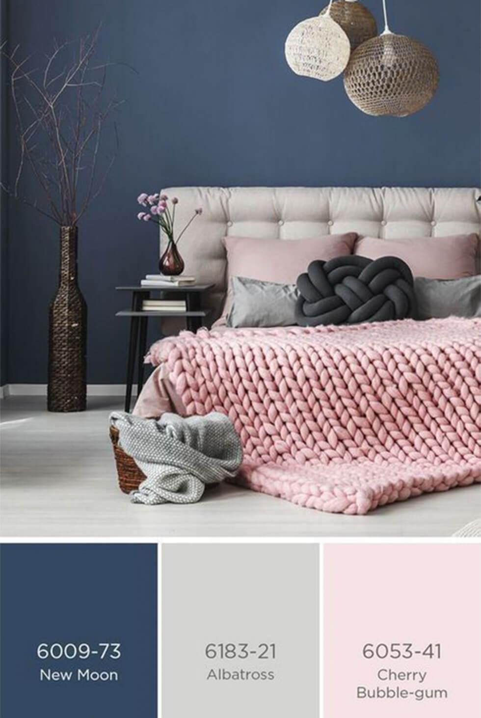A contemporary blue bedroom with grey and light pink pastel hues