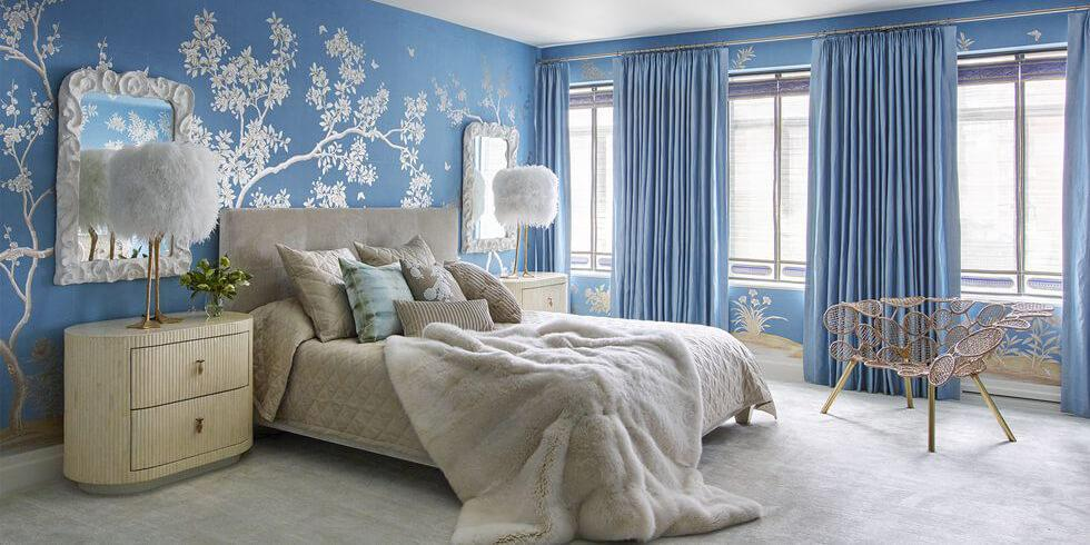 Blue bedroom with chinoiserie wallpaper and soft, cosy textures