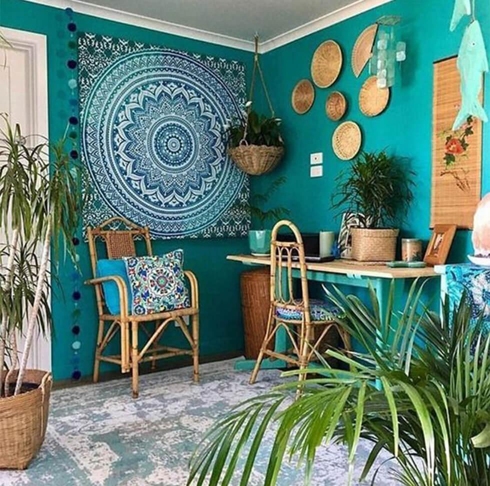 Bohemian bedroom with turquoise wall, rattan accessories and colourful wall hangings