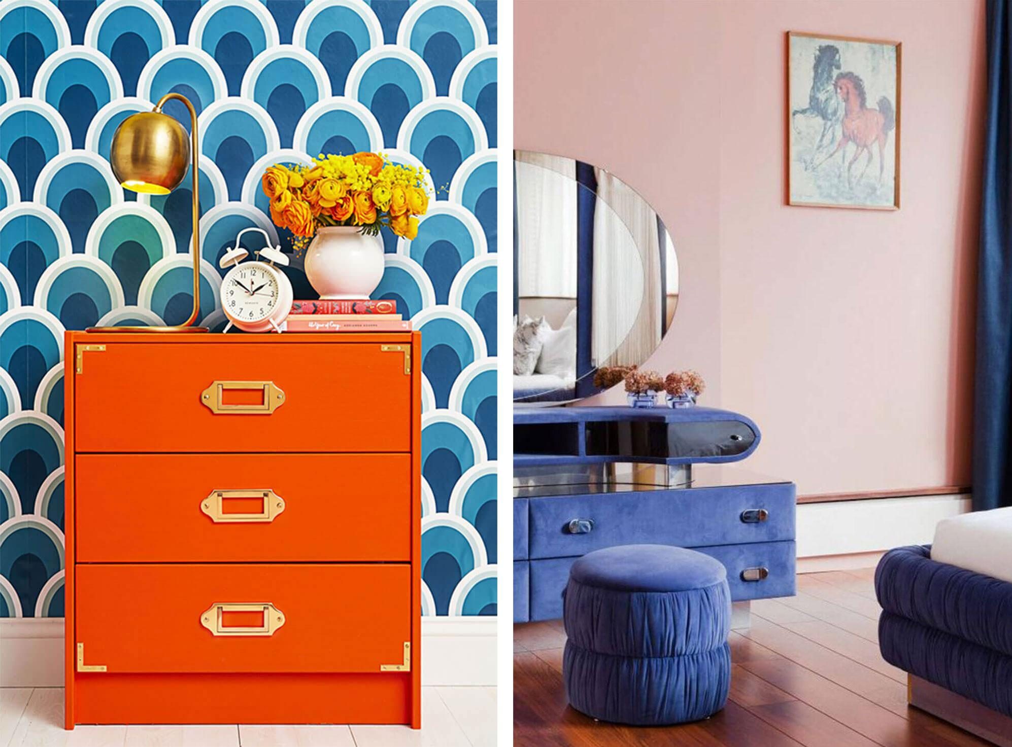 Vintage bright orange chest of drawers against blue patterned wallpaper